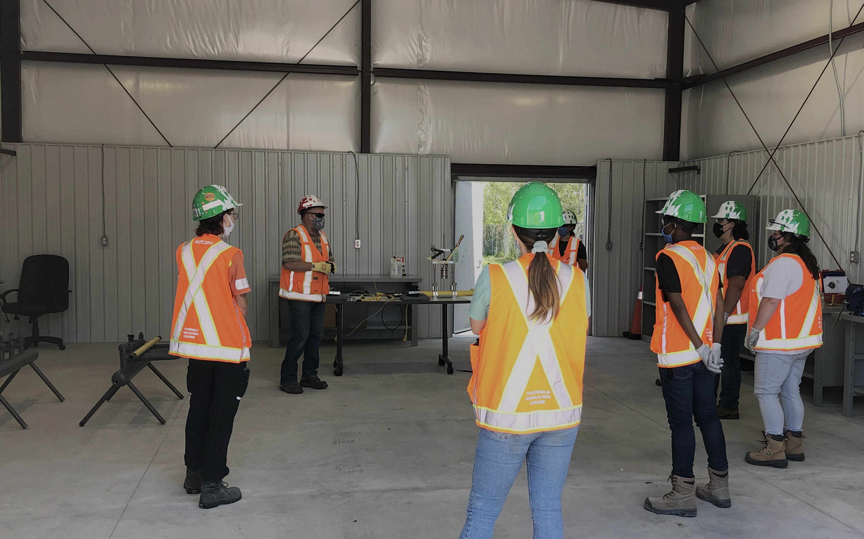 Aecon staff wearing safety gear and PPE on a site